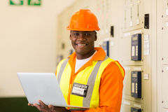 Engineer holding laptop Stock Image