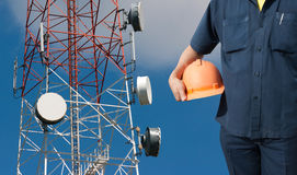 Free Engineer Holding Orange Helmet On Telecommunications Tower Royalty Free Stock Image - 56200236