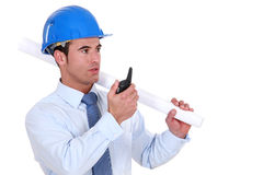 Engineer holding a rolled-up plan Royalty Free Stock Photo