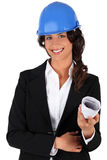 Engineer holding rolled up plans Royalty Free Stock Images