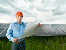 Engineer holding solar panel station plan Stock Images