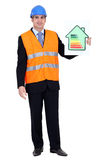 Engineer holding up efficiency chart. Engineer holding up an energy efficiency rating chart stock photo
