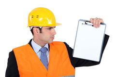 Engineer holding up note-pad Stock Photos