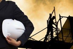 engineer holding white helmet Stock Photos