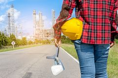 Engineer holding a yellow helmet. For the safety of workers Stock Image
