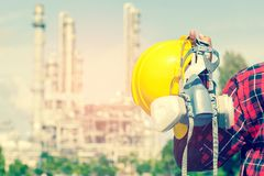 Engineer holding a yellow helmet. For the safety of workers Royalty Free Stock Image
