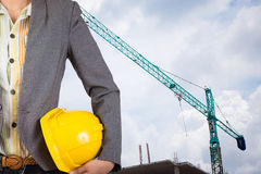 Engineer holding yellow helmet for workers security on backgroun Royalty Free Stock Images