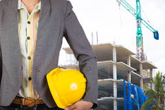 Engineer holding yellow helmet for workers security on backgroun Royalty Free Stock Photos