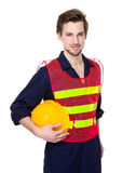 Engineer with holding yellow protective helmet Stock Photo
