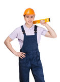 Engineer holds engineer's level Royalty Free Stock Photo