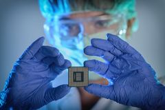 The engineer holds a processor in hands Stock Photo