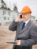 Engineer and house construction site Stock Photos