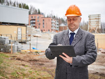 Engineer and house construction site Royalty Free Stock Photo
