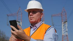 Engineer Image Maintenance Job text Using Cell Phone. Image with a Engineer Maintenance Job text Using Cell Phone royalty free stock photo