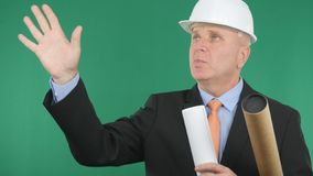 Engineer Image With Plans and Projects in Hand Talking And Gesturing stock image