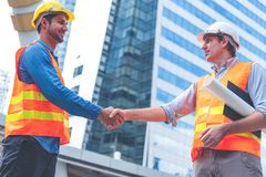 Free Engineer In Yellow Helmet And Best Greeting With Warm Handshake Manager Visiting Site. Modern Construction And Engineering Concept Royalty Free Stock Photography - 163545197
