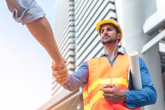 Free Engineer In Yellow Helmet And Best Greeting With Warm Handshake Manager Visiting Site. Modern Construction And Engineering Concept Stock Photo - 164822710