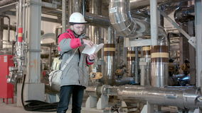 Engineer Inside Power Plant With Checklist stock video
