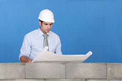 Engineer inspecting a blueprint Royalty Free Stock Photography