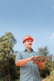 Engineer inspecting construction outdoors Royalty Free Stock Photo