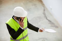 Engineer Inspecting Construction Site royalty free stock photography