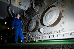 Engineer inspecting engine interior in offshore installation Stock Photo