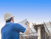 Engineer is inspecting his work. In building construction site Stock Photo