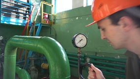 Engineer inspecting old water pump at factory. 4k stock footage