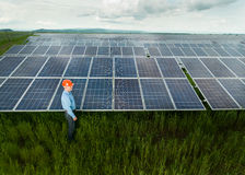 Engineer inspecting solar panels Stock Photography