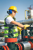Engineer  inspecting a valve Royalty Free Stock Photos