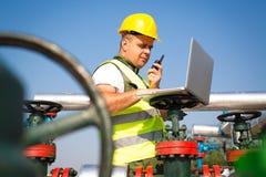 Engineer  inspecting a valve Stock Photos