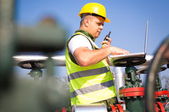 Engineer  inspecting a valve Royalty Free Stock Image