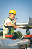 Engineer  inspecting a valve Royalty Free Stock Photography