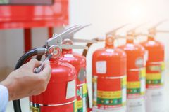 Engineer inspection Fire extinguisher. Engineer inspection Fire extinguisher and fire hose stock image
