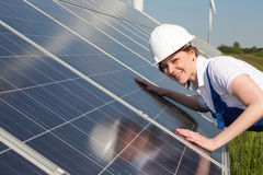 Engineer or installer inspecting solar energy panels stock image