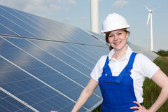 Engineer or installer posing with solar panels Royalty Free Stock Photo