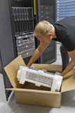 IT Engineer Installing New Router Stock Photography