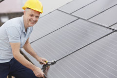 Free Engineer Installing Solar Panels On Roof Of House Royalty Free Stock Photo - 62893915
