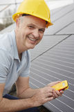 Engineer Installing Solar Panels On Roof Of House Stock Image