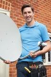Engineer Installing TV Satellite Dish Stock Photography