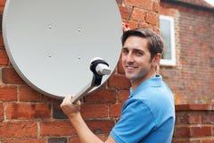 Engineer Installing TV Satellite Dish Royalty Free Stock Photos