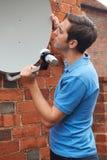 Engineer Installing TV Satellite Dish Royalty Free Stock Photography