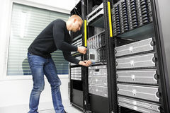 IT engineer installs blade server in datacenter Royalty Free Stock Photography