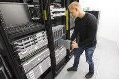 IT engineer installs blade server in datacenter Royalty Free Stock Photos