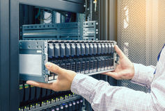 IT Engineer installs JBOD  to rack in datacenter Royalty Free Stock Image