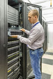 IT Engineer installs JBOD  to rack in datacenter Stock Photo