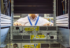 IT Engineer installs JBOD  to rack in datacenter Royalty Free Stock Photo