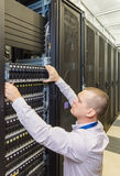 IT Engineer installs JBOD  to rack in datacenter Stock Image