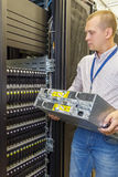 IT Engineer installs JBOD  to rack in datacenter Royalty Free Stock Photos