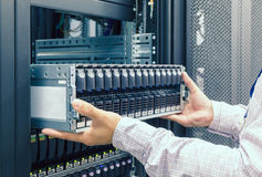 IT Engineer installs JBOD  to rack in datacenter Stock Photos